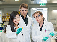Three researchers in the laboratory