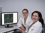 Researchers with a computer