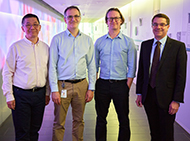 Four researchers smiling at camera
