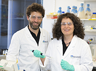 Tim Thomas and Anne Voss in a lab