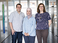 Three researchers smiling at camera