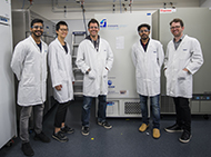Researchers with freezer