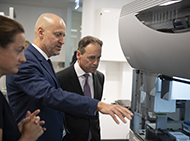 Researchers and Health Minister with robotic equipment