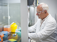 Professor Len Harrison working in a fume hood