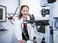 Dr Misty Jenkins at a microscop